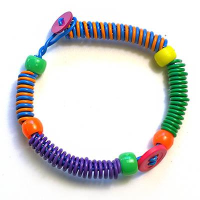 Coil bracelet button